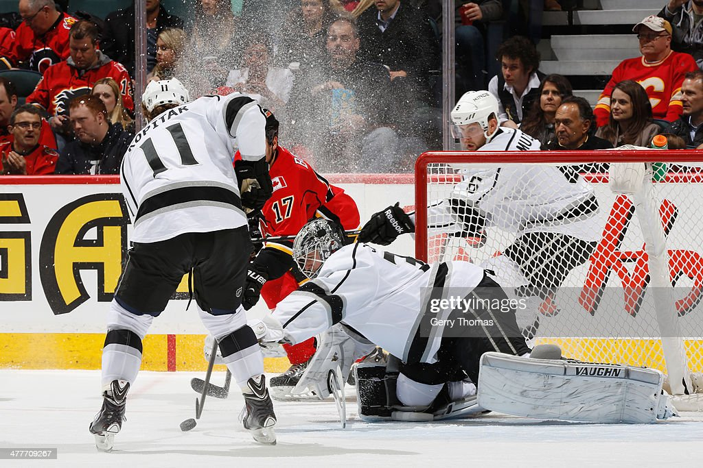 <a gi-track='captionPersonalityLinkClicked' href=/galleries/search?phrase=Lance+Bouma&family=editorial&specificpeople=4303790 ng-click='$event.stopPropagation()'>Lance Bouma</a> #17 of the Calgary Flames skates against <a gi-track='captionPersonalityLinkClicked' href=/galleries/search?phrase=Anze+Kopitar&family=editorial&specificpeople=634911 ng-click='$event.stopPropagation()'>Anze Kopitar</a> #11 and Martin Jones #31 of the Los Angeles Kings at Scotiabank Saddledome on March 10, 2014 in Calgary, Alberta, Canada.