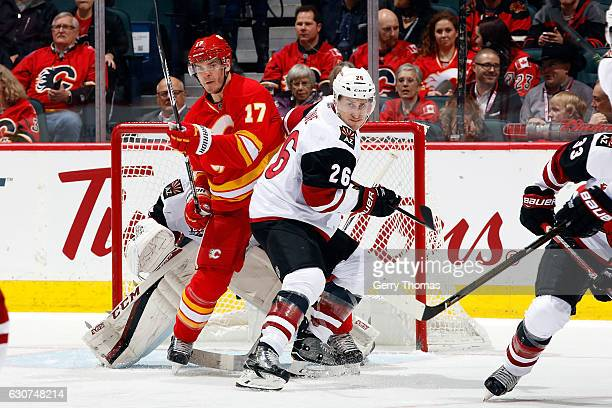 Lance Bouma of the Calgary Flames skates against Michael Stone of the Arizona Coyotes during an NHL game on December 31 2016 at the Scotiabank...