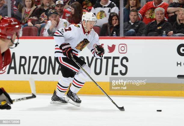 Lance Bouma of the Chicago Blackhawks skates with the puck against the Arizona Coyotes at Gila River Arena on October 21 2017 in Glendale Arizona