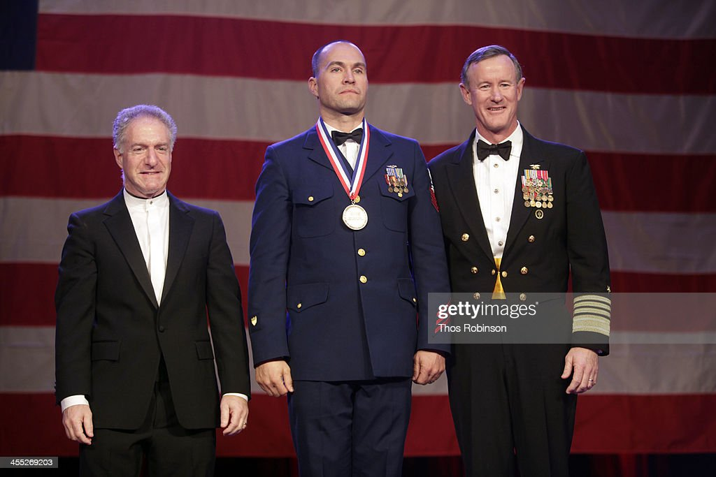 Lance Boxer, USO CEO, aviation survival technician second class Randy Haba, and admiral William McRaven attend 52nd USO Armed Forces Gala & Gold Medal Dinner at Marriott Marquis Times Square on December 11, 2013 in New York City.