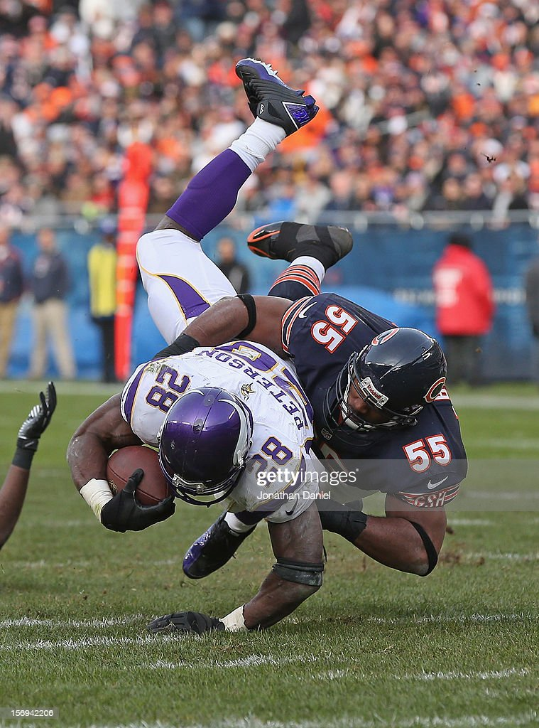 Lance Briggs #55 of the Chicago Bears brings down Adrian Peterson #28 of the Minnesota Vikings at Soldier Field on November 25, 2012 in Chicago, Illinois. The Bears defeated the Vikings 28-10.