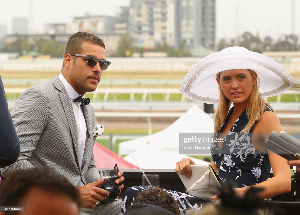 Lance 'Buddy' Franklin and <a gi-track='captionPersonalityLinkClicked' href=/galleries/search?phrase=Jesinta+Campbell&family=editorial&specificpeople=7056645 ng-click='$event.stopPropagation()'>Jesinta Campbell</a> (R) attend the Emirates marquee during Oaks Day at Flemington Racecourse on November 7, 2013 in Melbourne, Australia.