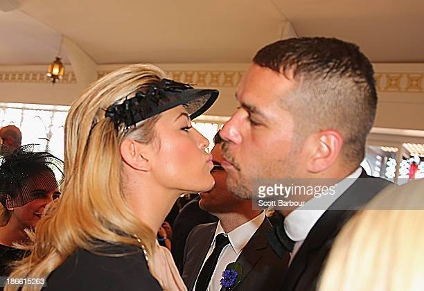 Lance 'Buddy' Franklin and Jesinta Campbell kiss as they attend the Emirates marquee on Victoria Derby Day at Flemington Racecourse on November 2...