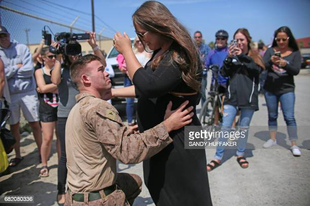 Lance Corp Shane McMain shares a moment with his wife Madison who is pregnant with their first child during a homecoming reception at Camp...
