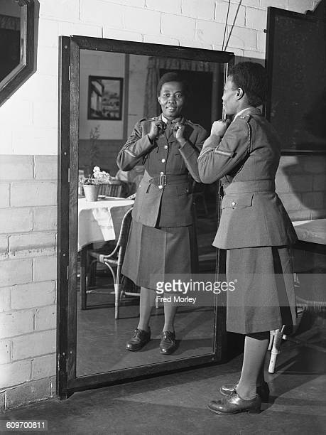 Lance Corporal Adina Williams of the British Auxiliary Territorial Service gets ready for parade UK 26th October 1942 Williams is a former nurse from...