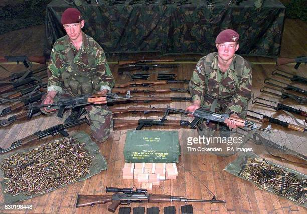 Lance Corporal James Collins from Paisley and Private Peter Omailley from Sterling of 1 Para display confiscated weapons at thier HQ in Pristina the...
