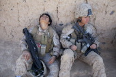 Lance Corporal Luz Lopez a US Marine with the FET 1st Battalion 8th Marines Regimental Combat team II and Riane Donoho 21 take a rest during a...