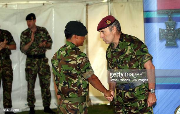 Lance Corporal Mohansingh Tangnami of the Royal Gurkha Rifles receives congratulations from Lt General Graeme Lamb on his award of a Military Cross...