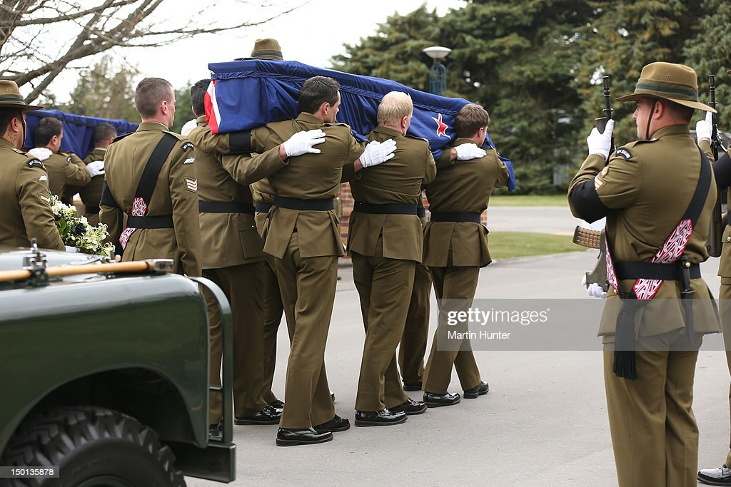 Lance Corporal Pralli Durrer is carried by members of his unit at the Military Commemorative Service for LCPL Durrer and LCPL Malone at Burnam Military Camp on August 11, 2012 in Christchurch, New Zealand. The bodies of the two New Zealand soldiers killed in Afghanistan arrived in Christchurch last night. Private funeral services will then be held by their families.