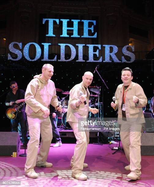 Lance Corporal Ryan Idzi Sergeant Major Gary Chilton and Sergeant Richie Maddocks rehearse at the Royal Albert Hall during their Coming Home Tour The...