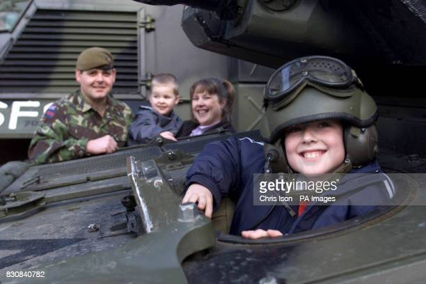 Lance Corporal Stuart Threadgold from Swansea of 1st Battalion Welsh Guards shows his sons James nine and Kyle two and wife Alison a Scimitar tank at...