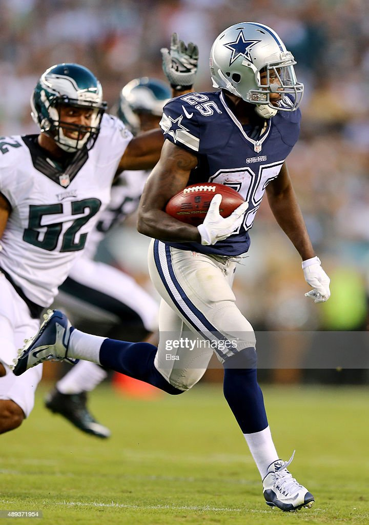Lance Dunbar #25 of the Dallas Cowboys carries the ball as Brad Jones #52 of the Philadelphia Eagles defends on September 20, 2014 at Lincoln Financial Field in Philadelphia, Pennsylvania.The Dallas Cowboys defeated the Philadelphia Eagles 20-10.