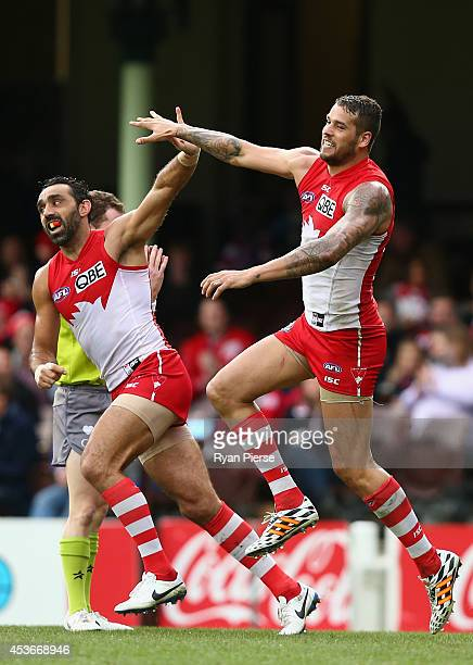 Lance Franklin and Adam Goodes of the Swans celebrate a goal during the round 21 AFL match between the Sydney Swans and the St Kilda Saints at Sydney...