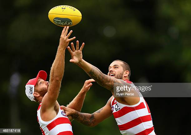 Lance Franklin and Jarrad McVeigh of the Swans train during a Sydney Swans AFL training session at Moore Park on March 4 2015 in Sydney Australia