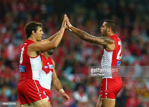 Lance Franklin and Kurt Tippett of the Swans celebrate a goal during the round eight AFL match between the Sydney Swans and the Hawthorn Hawks at ANZ...