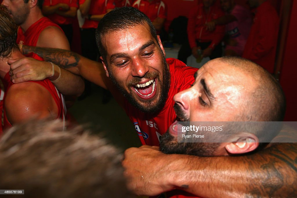 Lance Franklin and Rhyce Shaw of the Swans sings the club song after the round five AFL match between the Sydney Swans and the Fremantle Dockers at Sydney Cricket Ground on April 19, 2014 in Sydney, Australia.