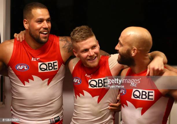 Lance Franklin Dan Hannebery and Jarrad McVeigh of the Swans sing the club song after the round 16 AFL match between the Sydney Swans and the Gold...