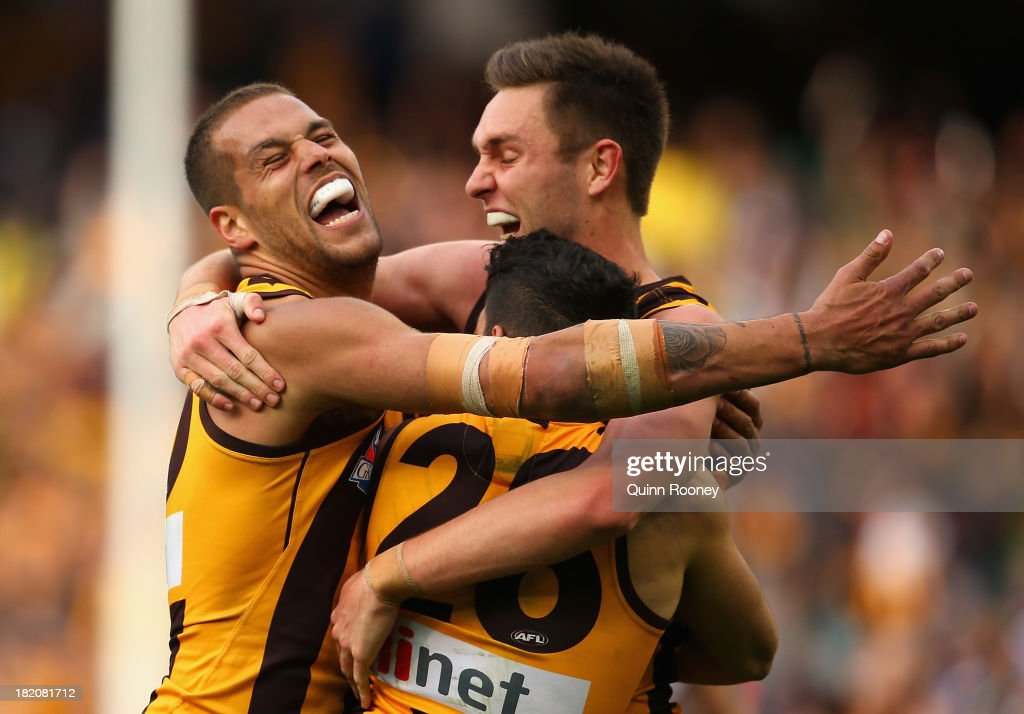 <a gi-track='captionPersonalityLinkClicked' href=/galleries/search?phrase=Lance+Franklin&family=editorial&specificpeople=561332 ng-click='$event.stopPropagation()'>Lance Franklin</a>, Jack Gunston and Paul Puopolo of the Hawks celebrate winning the 2013 AFL Grand Final match between the Hawthorn Hawks and the Fremantle Dockers at Melbourne Cricket Ground on September 28, 2013 in Melbourne, Australia.