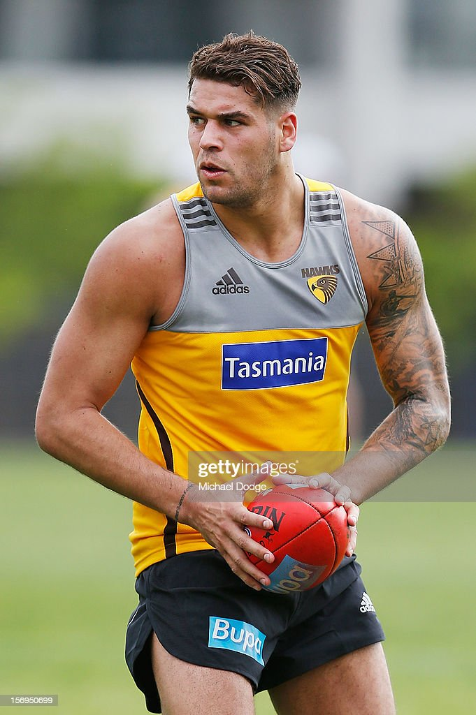 <a gi-track='captionPersonalityLinkClicked' href=/galleries/search?phrase=Lance+Franklin&family=editorial&specificpeople=561332 ng-click='$event.stopPropagation()'>Lance Franklin</a> looks to kick the ball during a Hawthorn Hawks pre-season AFL training session at Waverley Park on November 26, 2012 in Melbourne, Australia.