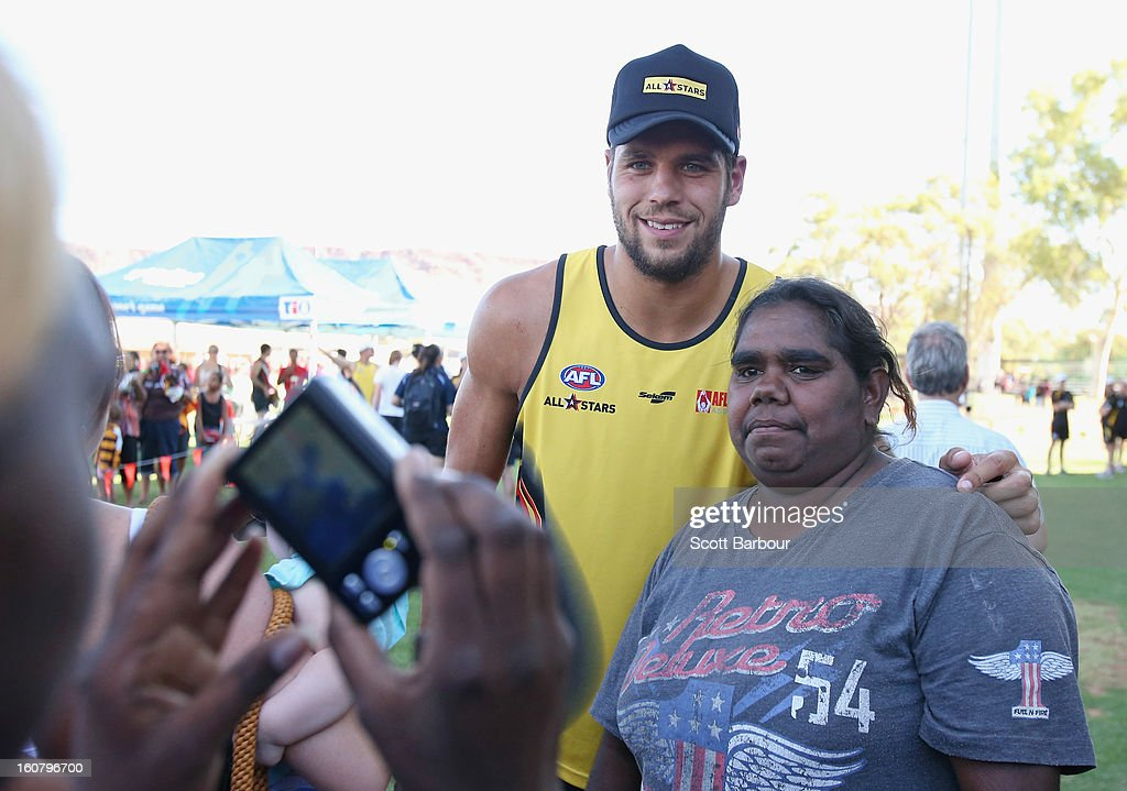 <a gi-track='captionPersonalityLinkClicked' href=/galleries/search?phrase=Lance+Franklin&family=editorial&specificpeople=561332 ng-click='$event.stopPropagation()'>Lance Franklin</a> of the All Stars poses for a photograph with a fan ahead of the AFL exhibition match between the Richmond Tigers and the Indigenous All Stars at Traeger Park on February 6, 2013 in Alice Springs, Australia.