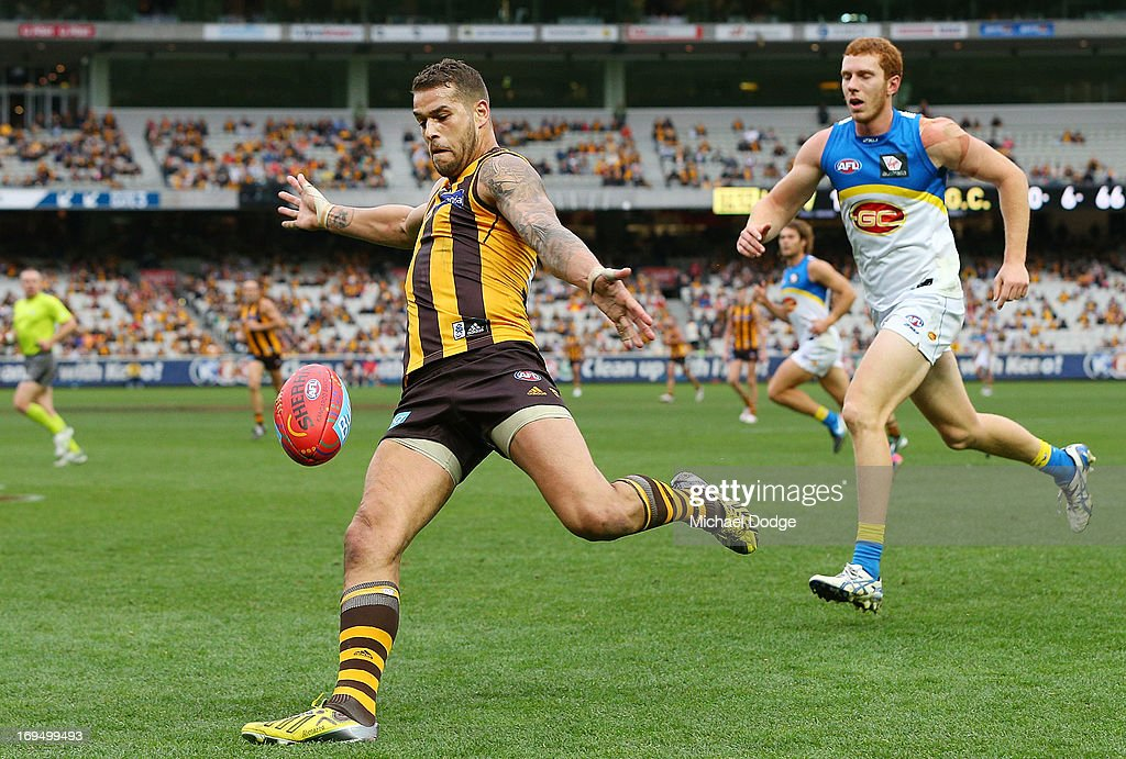 Lance Franklin of the Hawks kicks the ball for a goal during the round nine AFL match between the Hawthorn Hawks and the Gold Coast Suns at Melbourne Cricket Ground on May 26, 2013 in Melbourne, Australia.