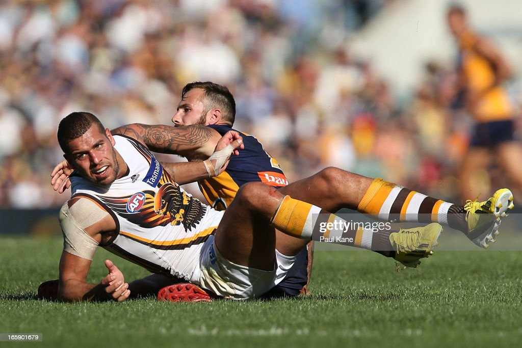 <a gi-track='captionPersonalityLinkClicked' href=/galleries/search?phrase=Lance+Franklin&family=editorial&specificpeople=561332 ng-click='$event.stopPropagation()'>Lance Franklin</a> of the Hawks looks on after being tackled by Chris Masten of the Eagles during the round two AFL match between the West Coast Eagles and the Hawthorn Hawks at Patersons Stadium on April 7, 2013 in Perth, Australia.