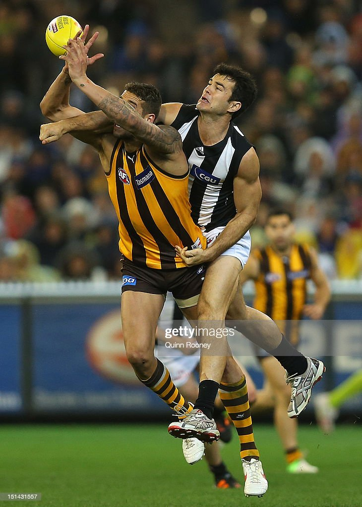 Lance Franklin of the Hawks marks infront of Chris Tarrant of the Magpies during the First AFL Qualifying Final match between the Hawthorn Hawks and the Collingwood Magpies at the Melbourne Cricket Ground on September 7, 2012 in Melbourne, Australia.