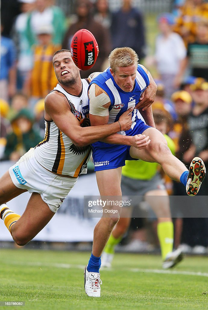 Lance Franklin of the Hawks tackles Liam Anthony of the Kangaroos during the AFL NAB Cup match between the North Melbourne Kangaroos and the Hawthorn Hawks at Highgate Recreational Reserve on March 16, 2013 in Craigieburn, Australia.