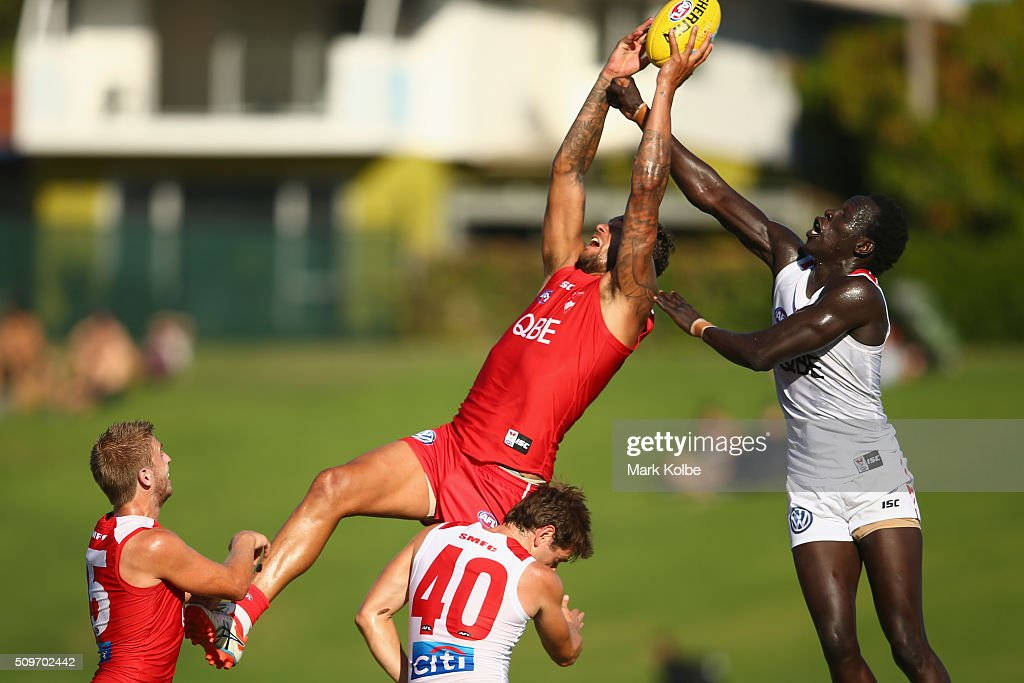 <a gi-track='captionPersonalityLinkClicked' href=/galleries/search?phrase=Lance+Franklin&family=editorial&specificpeople=561332 ng-click='$event.stopPropagation()'>Lance Franklin</a> of the Red Team and Aliir Aliir of the White Team compete for the ball during the Sydney Swans AFL intra-club match at Henson Park on February 12, 2016 in Sydney, Australia.