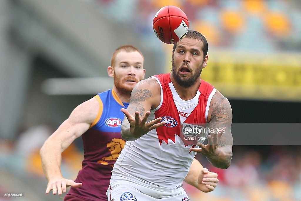 Lance Franklin of the Swans and Daniel Merrett of the Lions compete for the ball during the round six AFL match between the Brisbane Lions and the Sydney Swans at The Gabba on May 1, 2016 in Brisbane, Australia.