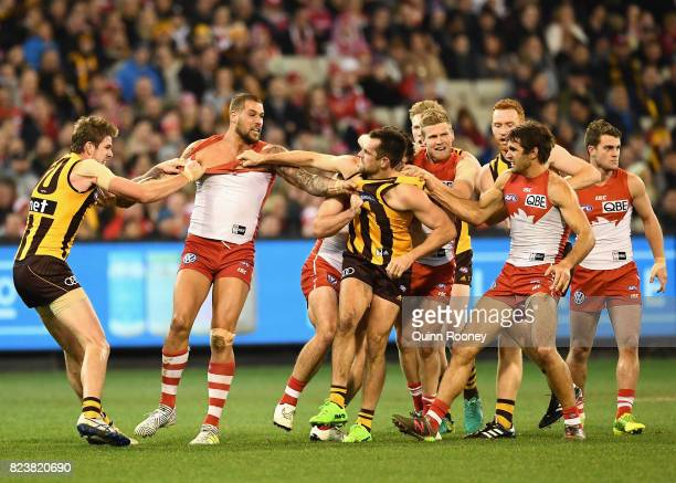 Lance Franklin of the Swans and Luke Hodge of the Hawks push and shove during the round 19 AFL match between the Hawthorn Hawks and the Sydney Swans...