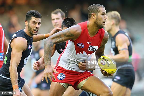 Lance Franklin of the Swans breaks through a tackle during the NAB Challenge AFL match between the Carlton Blues and the Sydney Swans at Etihad...