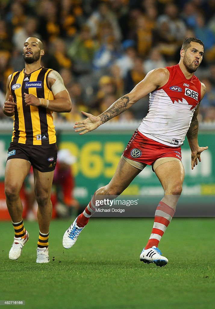 <a gi-track='captionPersonalityLinkClicked' href=/galleries/search?phrase=Lance+Franklin&family=editorial&specificpeople=561332 ng-click='$event.stopPropagation()'>Lance Franklin</a> of the Swans celebrates a goal past Josh Gibson of the Hawks during the round 18 AFL match between the Hawthorn Hawks and the Sydney Swans at Melbourne Cricket Ground on July 26, 2014 in Melbourne, Australia.