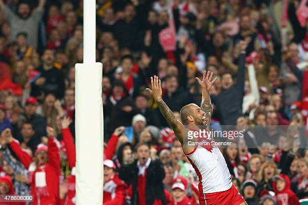 Lance Franklin of the Swans celebrates a Swans goal during the round 13 AFL match between the Sydney Swans and the Richmond Tigers at SCG on June 26...