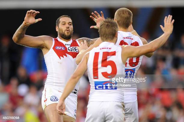 Lance Franklin of the Swans celebrates with goal scorer Sam Reid during the round 12 AFL match between the Gold Coast Suns and Sydney Swans at...