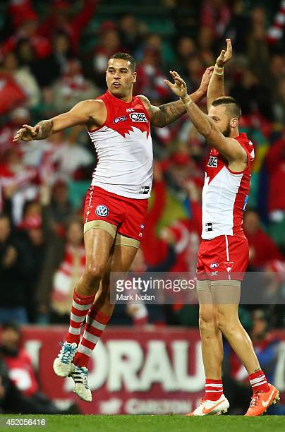 Lance Franklin of the Swans celebrates with team mates after kicking a goal during the round 17 AFL match between the Sydney Swans and the Carlton...