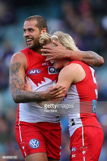 Lance Franklin of the Swans congratulates Isaac Heeney after kicking a goal during the round 19 AFL match between the Fremantle Dockers and the...