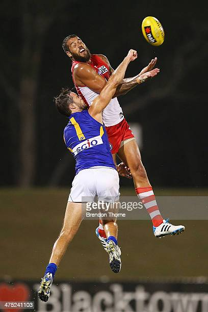 Lance Franklin of the Swans contests a mark with Mitch Brown of the Eagles during the round three NAB Challenge match between the Sydney Swans and...