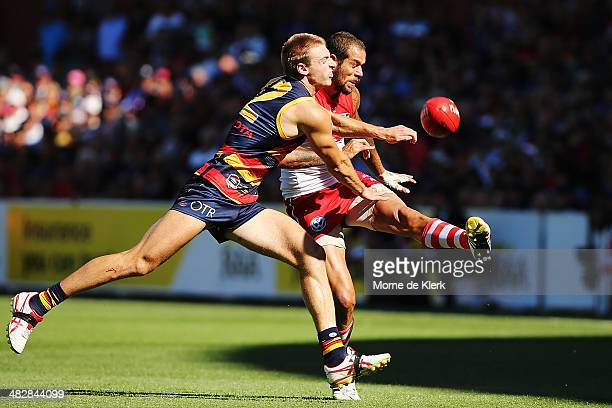 Lance Franklin of the Swans gets a kick away while under pressure from Daniel Talia of the Crows during the round three AFL match between the...