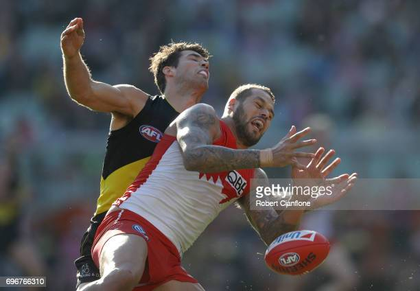 Lance Franklin of the Swans is challenged by Alex Rance of the Tigers during the round 13 AFL match between the Richmond Tigers and the Sydney Swans...
