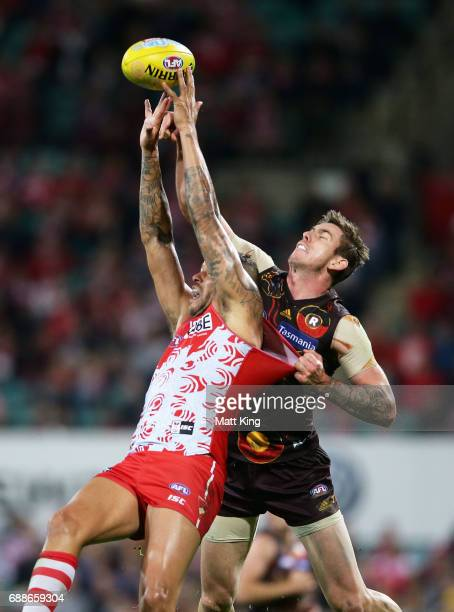 Lance Franklin of the Swans is challenged by Kaiden Brand of the Hawks during the round 10 AFL match between the Sydney Swans and the Hawthorn Hawks...