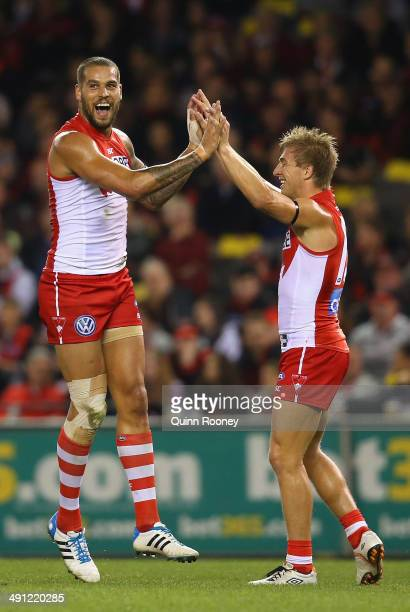 Lance Franklin of the Swans is congratulated by Kieren Jack after kicking a goal during the round nine AFL match between the Essendon Bombers and the...