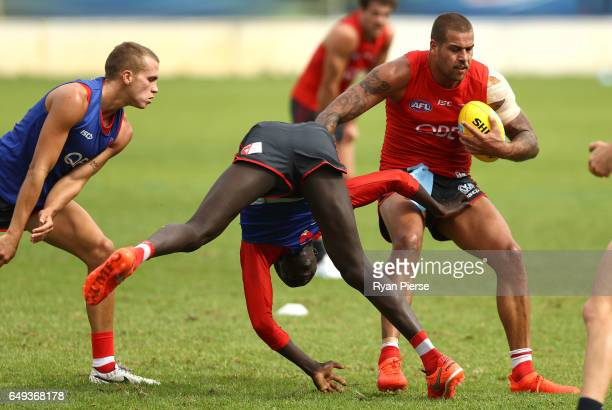 Lance Franklin of the Swans is tackled by Aliir Aliir Of the Swans during a Sydney Swans AFL training session at Lakeside Oval on March 8 2017 in...