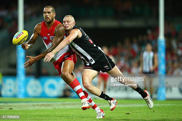 Lance Franklin of the Swans is tackled by Jack Frost of the Magpies during the round one AFL match between the Sydney Swans and the Collingwood...
