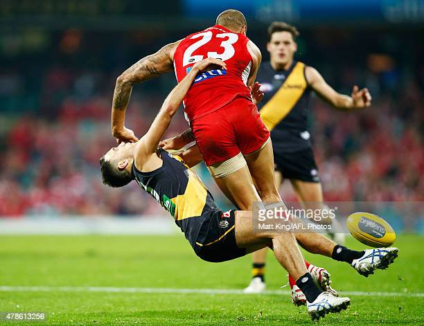 Lance Franklin of the Swans knocks down Shane Edwards of the Tigers during the round 13 AFL match between the Sydney Swans and the Richmond Tigers at...