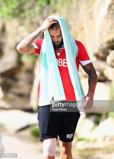 Lance Franklin of the Swans looks on during a Sydney Swans AFL recovery session at Coogee Beach on March 16 2014 in Sydney Australia