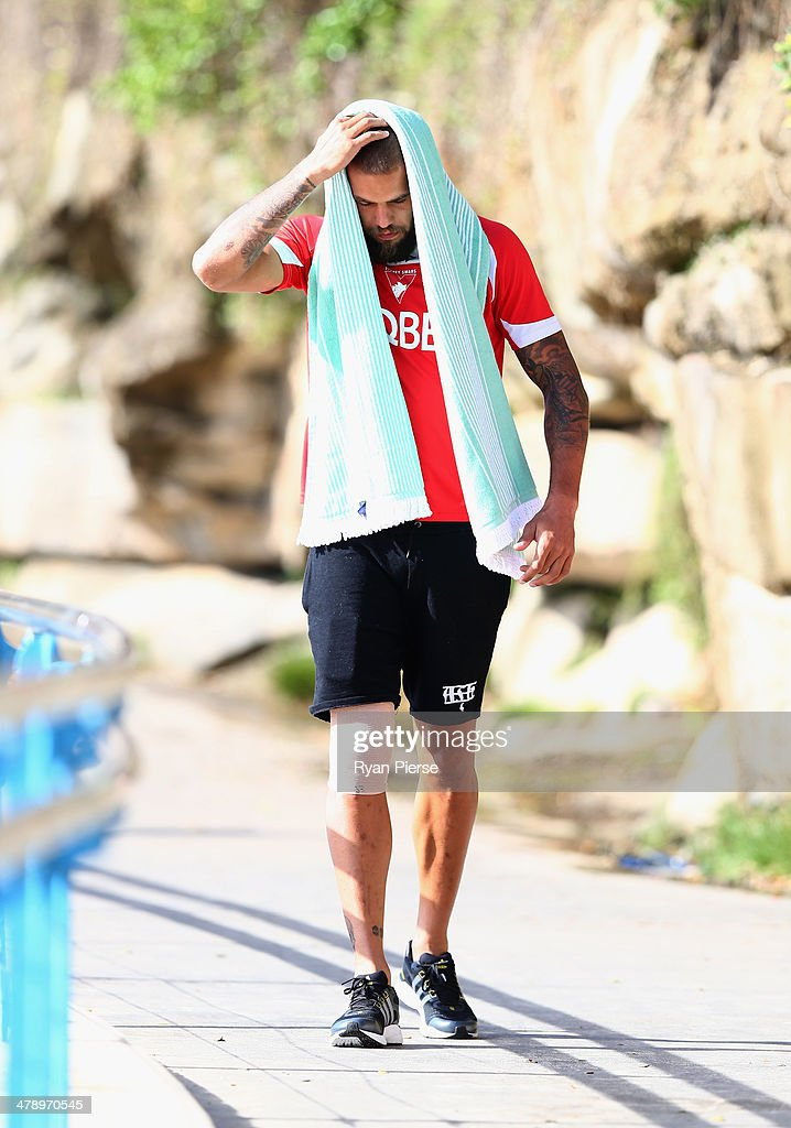 Lance Franklin of the Swans looks on during a Sydney Swans AFL recovery session at Coogee Beach on March 16, 2014 in Sydney, Australia.