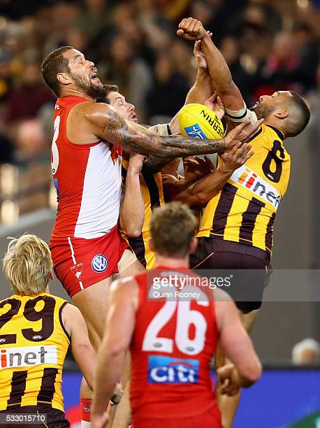 Lance Franklin of the Swans marks infront of Josh Gibson of the Hawks during the round nine AFL match between the Hawthorn Hawks and the Sydney Swans...