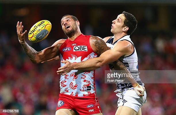Lance Franklin of the Swans marks over Harry Taylor of the Cats during the round 11 AFL match between the Sydney Swans and the Geelong Cats at the...