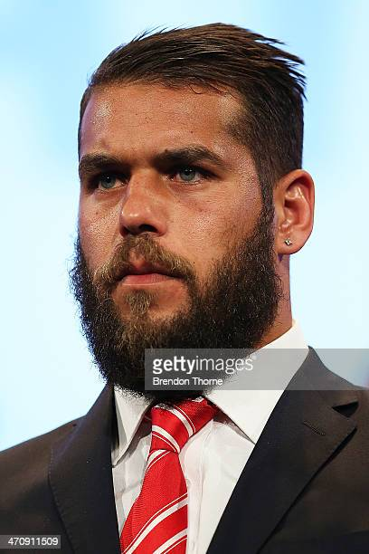Lance Franklin of the Swans stands on stage after receiving his 2014 Sydney Swans guernsey during the Sydney Swans AFL guernsey presentation and Hall...